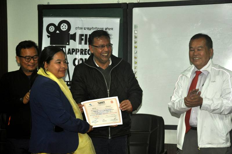 Assistant Professor, Dr Meenakumari Angom receiving the participant's certificate