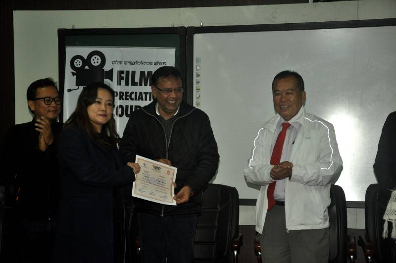 Assistant Professor, Smt Natasha Elangbam receiving the participant's certificate