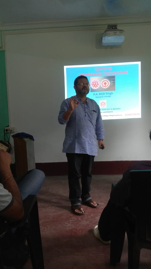 RK. Birjit Singh making his point in a Seminar on COVID19 at Mangolnganbi College on the 17th June,2020.